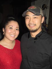 Jonathan Mah, owner of Sidestreet Burgers, and Mary He were at Urban Fusion Asian Bistro soft opening.