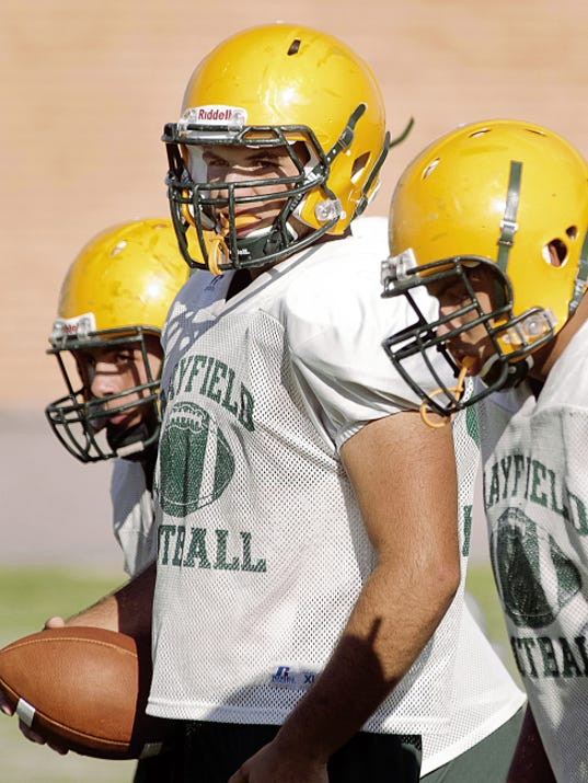 Gary Mook -- For the Las Cruces Sun-News   Mayfield center Colton Evans, middle, is the lone returning starter on the Trojans offensive line and will be looked at to provide leadership for the younger players.