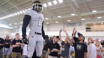 The Vanderbilt football team unveiled a new Nike alternate uniform and helmet during its annual Dore Jam fan event on Sunday.