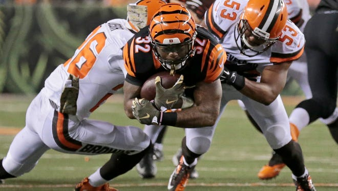 Cincinnati Bengals running back Jeremy Hill (32) dives for extra yards on a carry in the third quarter of the NFL Week 9 game between the Cincinnati Bengals and the Cleveland Browns at Paul Brown Stadium in downtown Cincinnati on Thursday, Nov. 5, 2015. The Bengals improved to 8-0 for the first time in franchise history with a 31-10 victory over Cleveland in the Battle of Ohio game.