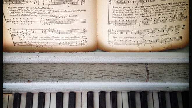 Piano with sheet music illustration.
