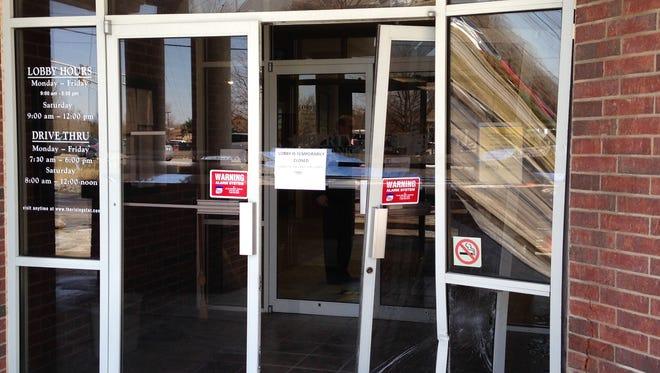 Police say a car drove into this Springfield bank Friday.