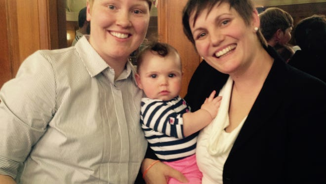 A pediatrician refused to treat Bay Contreras, center, the daughter of Jami and Krista Contreras of Oak Park, Mich., because they are a same-sex couple.