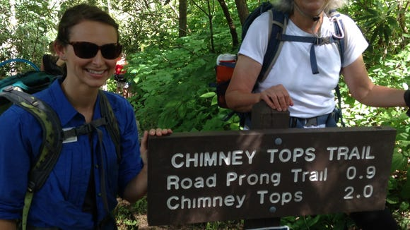 Danny Bernstein, right, starts off on a hike on the Chimney Tops Trail in the Smokies with Anna Lee Zanetti, left, of Friends of the Smokies.