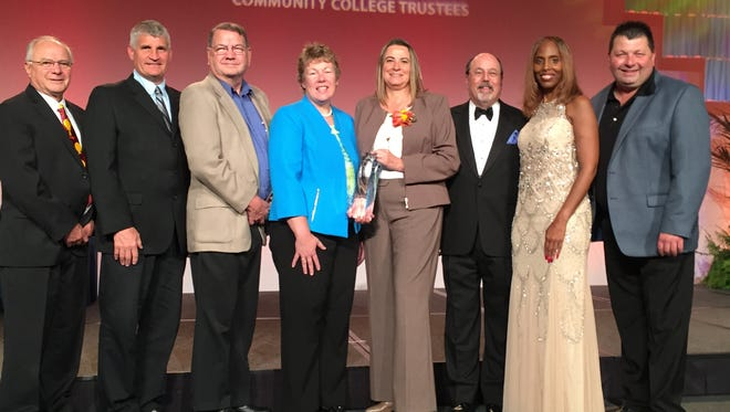 Val Krueger, recipient of the 2015 Professional Board Staff Member National Award, with Moraine Park Board and ACCT members. From left: Moraine Park District Board Members Mike Miller, Mike Staral and Lowell Prill; Moraine Park President Bonnie Baerwald; Val Krueger; ACCT President J. Noah Brown; ACCT Chair and Lansing Community College Trustee Robin Smith; and Moraine Park District Board Chair Vernon Jung.