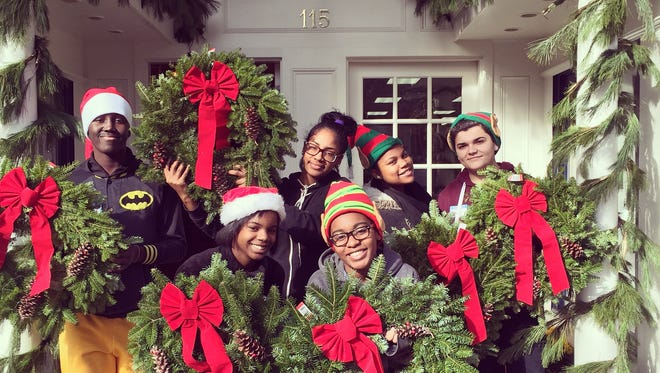 Shoppers can purchase handmade wreaths and other holiday items from LUCY, an outreach group for Camden youth.