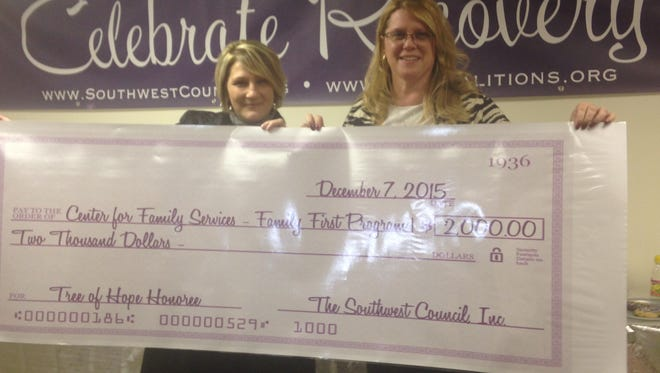 (From left) Theresa Humphrey, counselor, Intensive Outpatient Program, and Therese Benyola, program director, both from the Center for Family Services in Glassboro and both affiliated with the center'sFamily First Program, accept a donation for the program from The Southwest Council's Tree of Hope event.