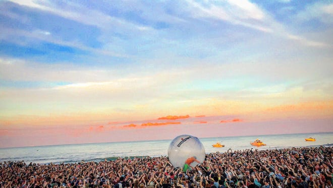 Flaming Lips lead singer Wayne Coyne rides over the audience at the Gentlemen of the Road Stopovers festival in Seaside Heights on June 6.