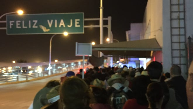 Pedestrians are waiting at least 25 minutes to cross into downtown El Paso.