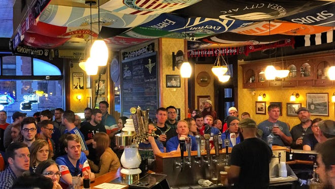 "Multiple FC Cincinnati supporters groups gathered to watch the game at Molly Malone's Irish Pub and Restaurant at 112 E. Fourth Street in Covington. About 65 fans crowded the bar, prompting a waitress to comment at one point, ""this is a free-for-all."""