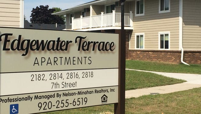 The new sign for Edgewater Terrace Apartments sits in front of the apartment buildings which have new roofs and siding.