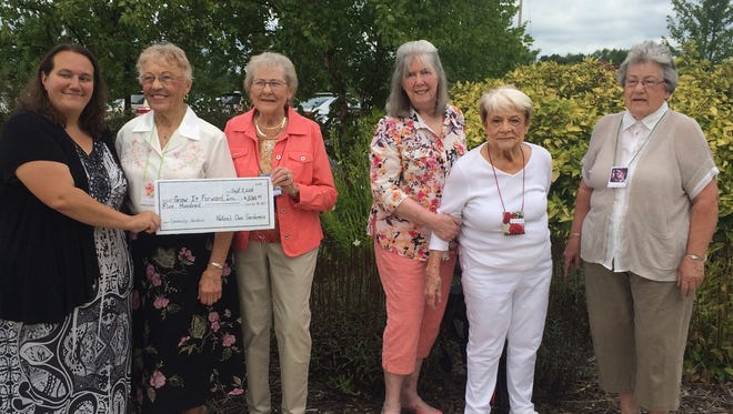 (From left) Grow It Forward CEO and founder Amber Daugs with Nature's Own Gardeners Charter Members Joan Schanke, Helen Demsien, Barbara Decker, Elsie Crouch and Lane Radzinske. Nancy Censky, another charter member of the club, was unable to be at the celebration.