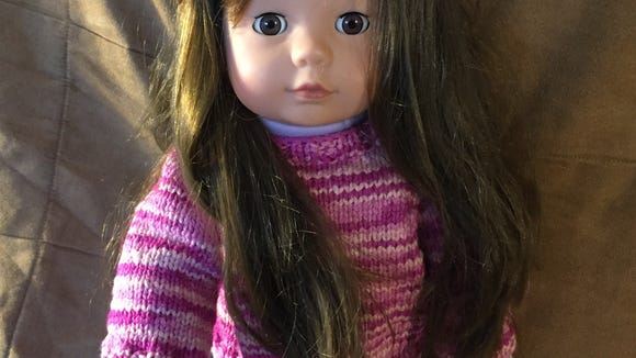 This is my Goetz Pottery Barn doll, who I named Kimmy. She is wearing a sweater I made.