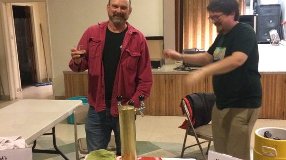 Home brewers serve up their creations at a past home brew tasting.
