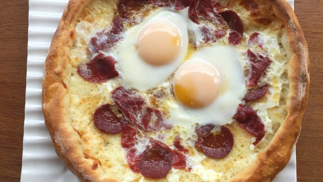 Cinar pide topped with eggs