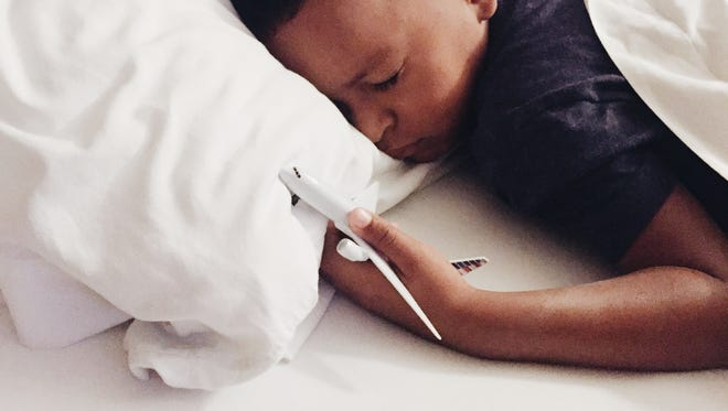 Four-year-old Jalil sleeps with a toy airplane he received as a gift from his uncle, who, along with the child's aunt, has spent years trying to adopt him.