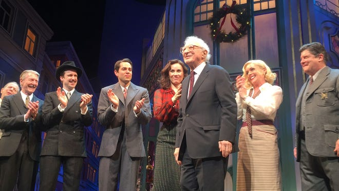 "Sheldon Harnick takes a bow on the opening night of the 2016 revival of his play ""She Loves Me."" Actresses Laura Benanti, L, and Jane Krakowski on either side of Mr. Harnick."