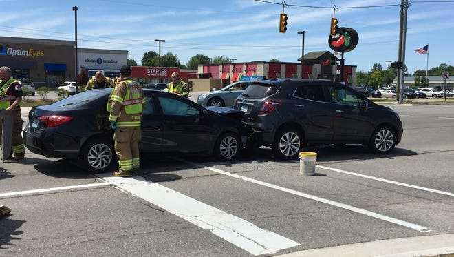 One person was injured in a crash in front of Birchwood Mall Thursday.