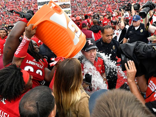 Louisville head coch Bobby Petrino gets the doused