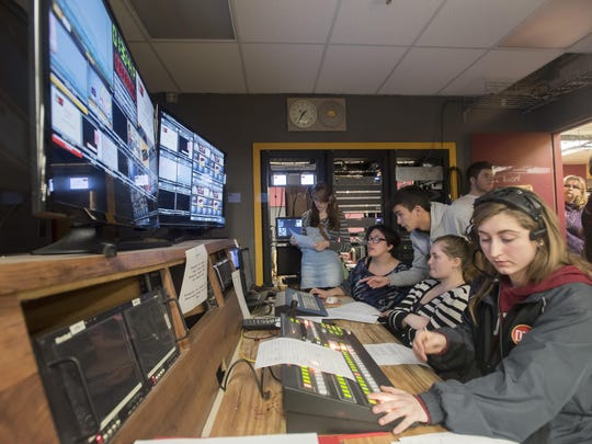 Students pack the control room during a live news broadcast. The 25-member staff works two hours to write and edit newscasts every day except Wednesday.