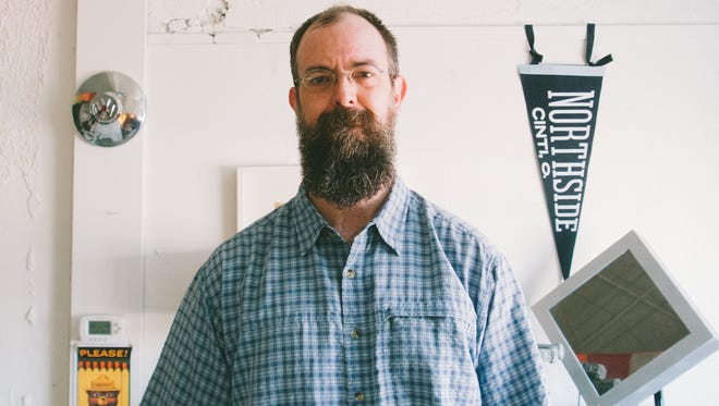 Chris Glass, 44, of Northside, is one of two winners of the 2016 Haile Fellowship. The graphic designer won the $100,000 grant that will allow him a year to focus on a photography project to take picture of every Cincinnati neighborhood inside the Interstate-275 beltway.