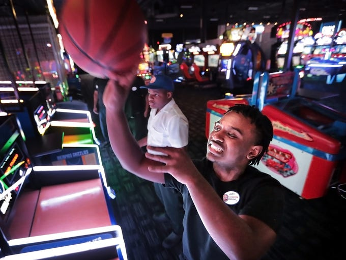 James Little shoots some hoops in the arcade at Memphis'
