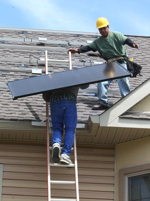 Solar panels are installed on a house in Walden, N.Y. by YSG/Solar.