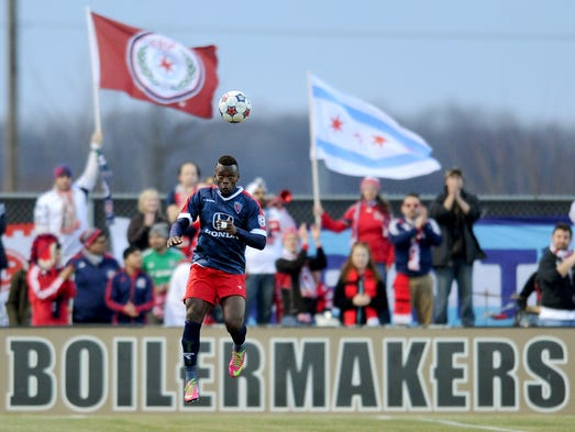 Indy Eleven defender Erick Norales heads the ball against the Chicago Fire reserve team at the Boilermaker Soccer Complex, Tuesday, April 1, 2014, in West Lafayette.
