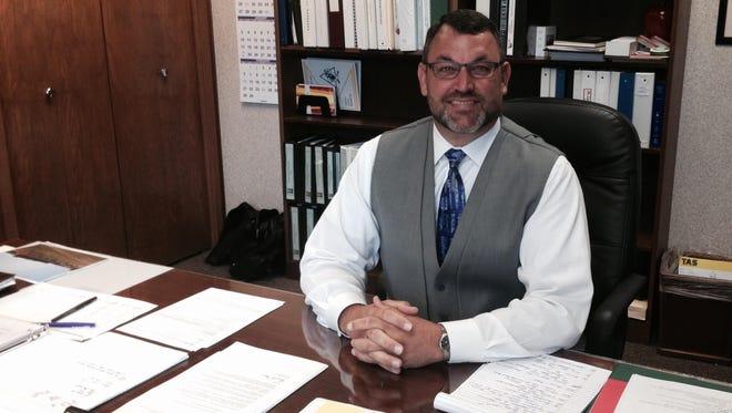 Delaware Community Schools Superintendent Reece Mann in his office in 2015.