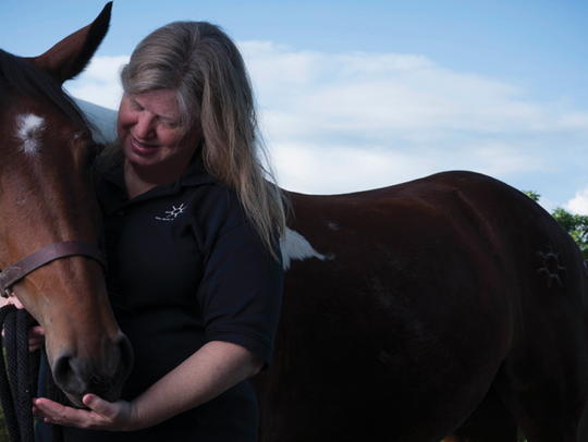 Esther Roberts with Kaliwohi, formerly a wild mustang