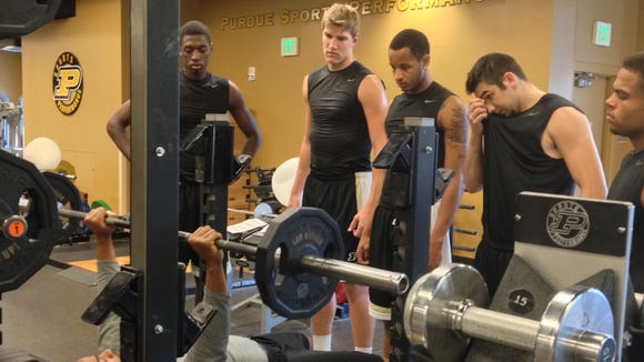 Purdue strength and conditioning assistant Gavin Roberts demonstrates a lift technique for basketball freshmen Jacquil Taylor (from left), Isaac Haas, Vince Edwards, Dakota Mathias and P.J. Thompson.