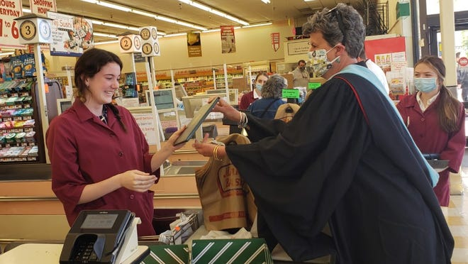 Lily Nicholson, of Exeter, received her high school diploma from Western Reserve Academy during her shift at Market Basket. Her advisor drove from Ohio to deliver it to her.