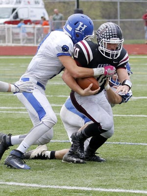 Elmira fullback Charlie Mahon is brought down by two Horseheads tacklers Saturday during the Express' 38-14 win in a Section 4 Class AA semifinal at Marty Harrigan Field.