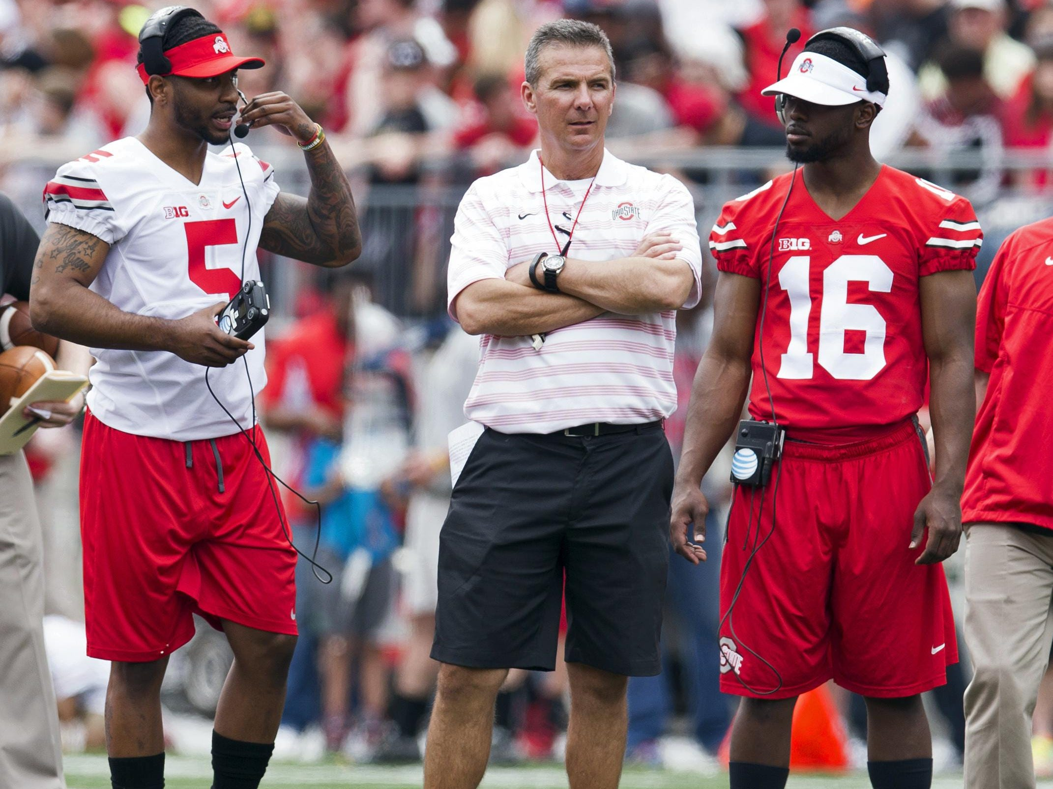 Ohio State coach Urban Meyer is flanked by Braxton Miller and J.T. Barrett at this year's spring game. Miller is switching from quarterback to receiver after a second surgery on his throwing shoulder.
