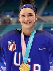 Gold medalist Megan Keller of the United States celebrates