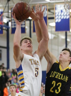 Howards Grove's Eric Reinemann (5) shoots past Sheboygan Lutheran's Jacob Ognacevic on Friday at Howards Grove.