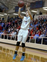 Gibson County's Erin Lannom pulls up for a jump shot during the Region 7-A championship game against Dresden Wednesday evening.