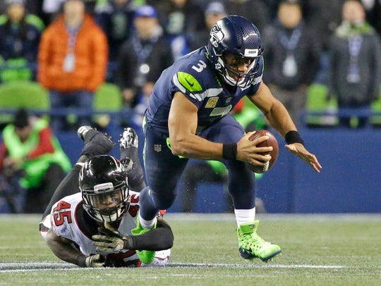 Russell Wilson threw for 258 yards and ran for 86 more