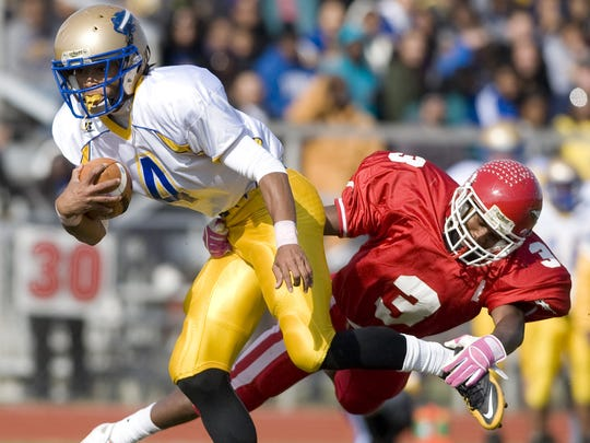 Woodbury graduate Anthony Averett (left) tries to break away from a Paulsboro defender during the 2010 season.
