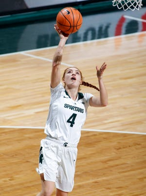 Michigan State's Taryn McCutcheon gets a fast-break layup after stealing the ball against Northwestern, Wednesday, Jan. 3, 2018, in East Lansing, Mich. MSU won 81-51.