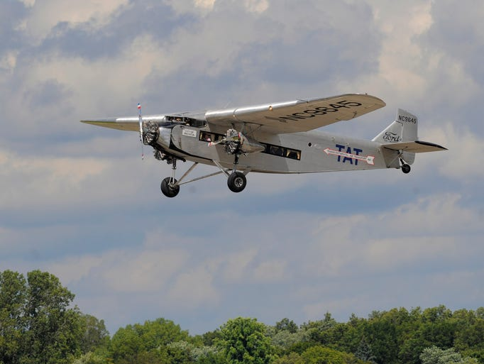 The vintage Ford Tri-Motor plane takes off on Thursday