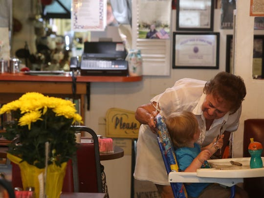 """Klassique Kafe owner Kathie Steers greets a very young customer Monday at the Restaurant in Redding. """"All of our customers are special,"""" Steers said."""