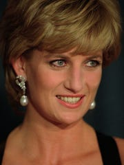 Princess Diana smiles at the United Cerebral Palsy