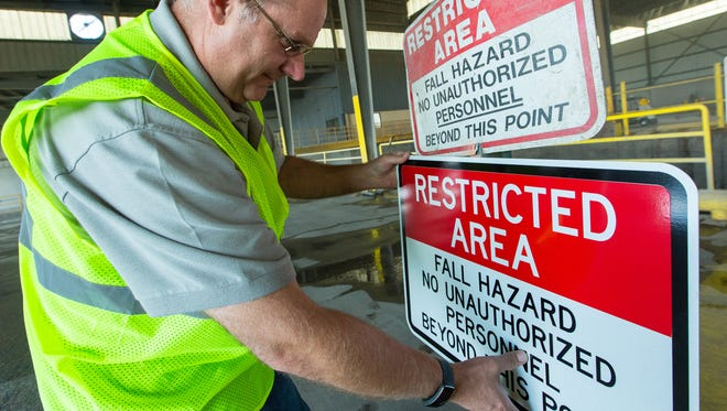 South Central Solid Waste Authority regulatory compliance specialist Steve Mauer shows specific sign improvements on Friday May, 13, 2016, that are being made at the facility after working with OSHA to ensure the workplace is safe.