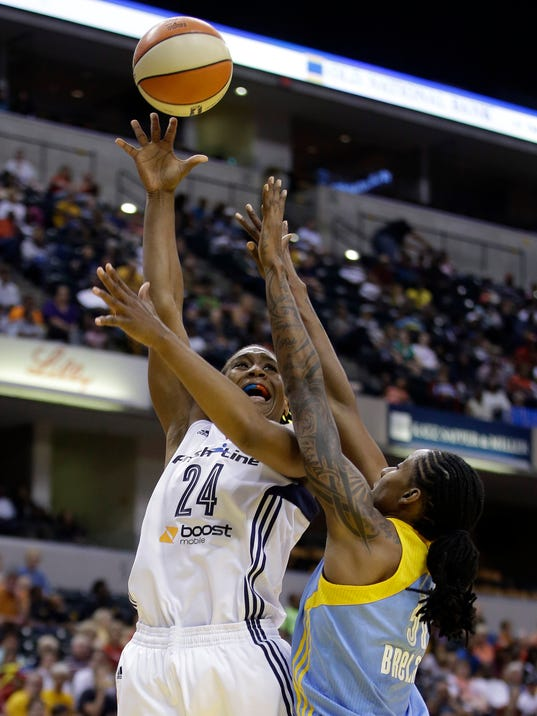 Indiana Fever's Tamika Catchings puts up a shot against Chicago Sky's Jessica Breland during the first half of a WNBA basketball game Thursday, July 17, 2014, in Indianapolis. (AP Photo/Darron Cummings)