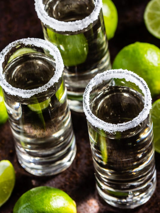 Tequila shot with lime and salt, selective focus