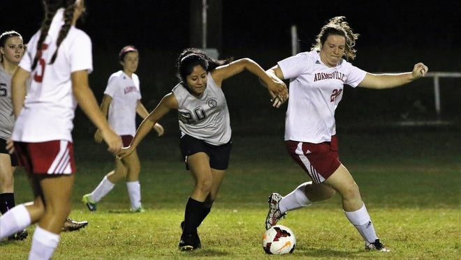 Adamsville's Madison Hollin (right) and Wayne County's Sara Sanchez (left) fight for the ball in the District 11-A semifinals on Oct. 9, 2017.