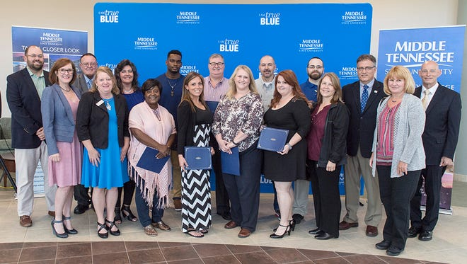 MTSU faculty and staff are shown with nine of 13 students who attended Tuesday's ceremony to receive the first certificates through University College's Applied Leadership program. The ceremony was held in the Miller Education Center Atrium on Bell Street.