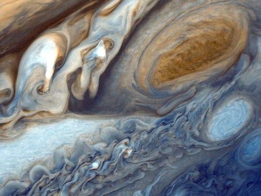 Jupiter's Giant Red Spot may be responsible for the planet's unusually hot atmosphere.