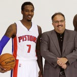 Detroit Pistons coach Stan Van Gundy stands with guard Brandon Jennings in Auburn Hills on Sept. 29, 2014.